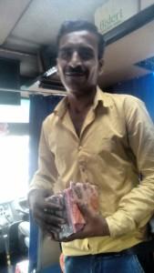 Vikas Kumar selling plastic table cloth.  Photo Credit: Navraj Bhatia