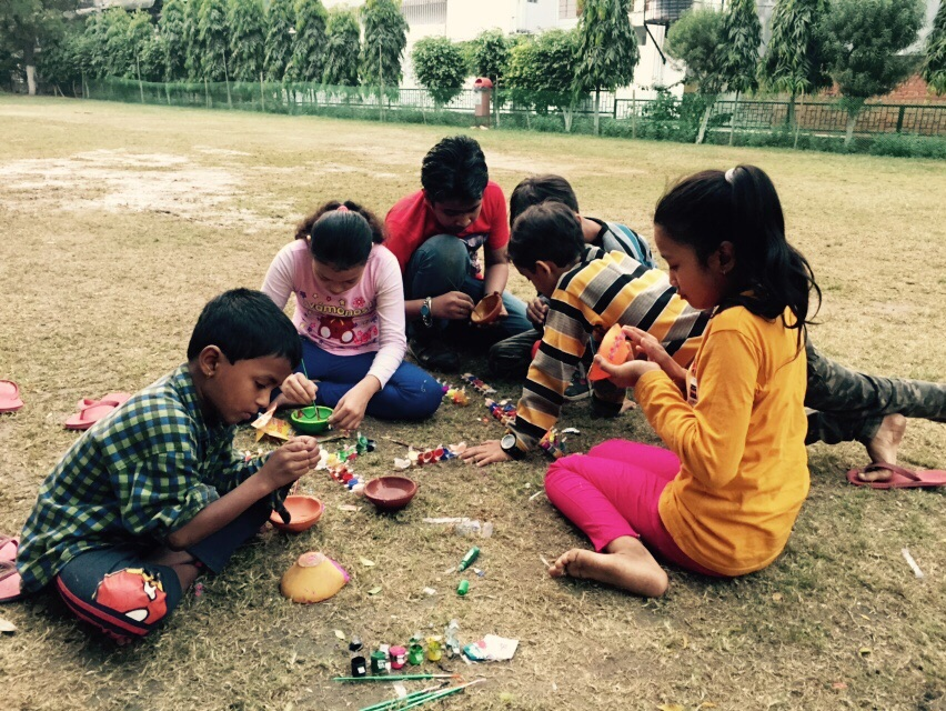 Children working on the Diwali decorations.  Photo credit: Anjali Ahuja