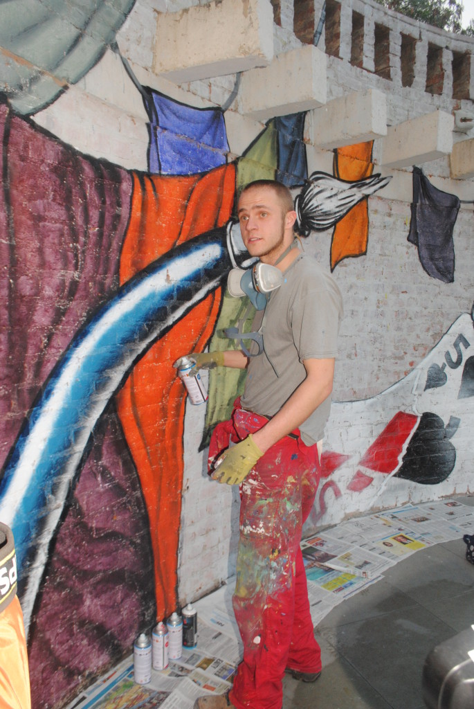 Artist Jeremias Altmann is creating a wall painting near the amphitheatre at Dilli Haat, INA, the hub of all cultural activities.