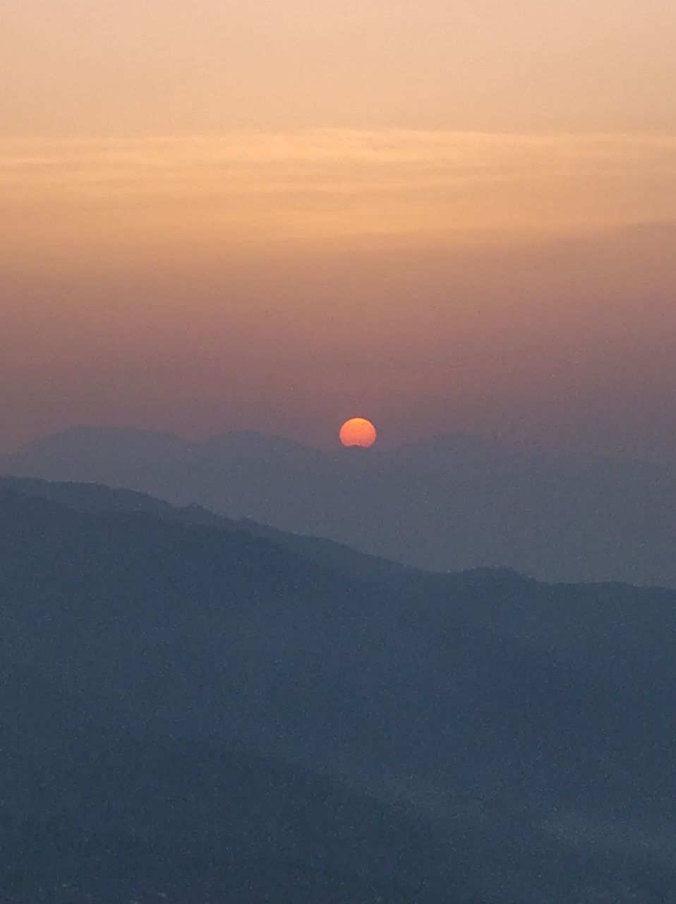 We witnessed the most stunning sunset at Chauli ki Jali behind the Mukteshwar Temple cliff.
